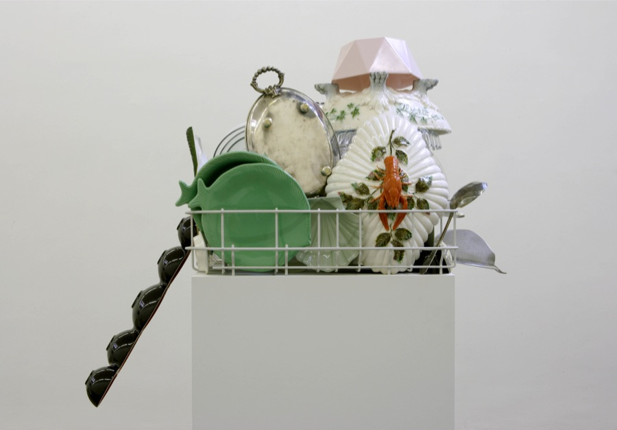 Nicole Wermers,   Abwaschskulptur (dishwashing sculpture) #8,   2013,   various china,   ceramic,   glass- and kitchen utensils,   arranged in modified dishwasher basket,   plinth,   courtesy S.A.L.E.S,   Roma