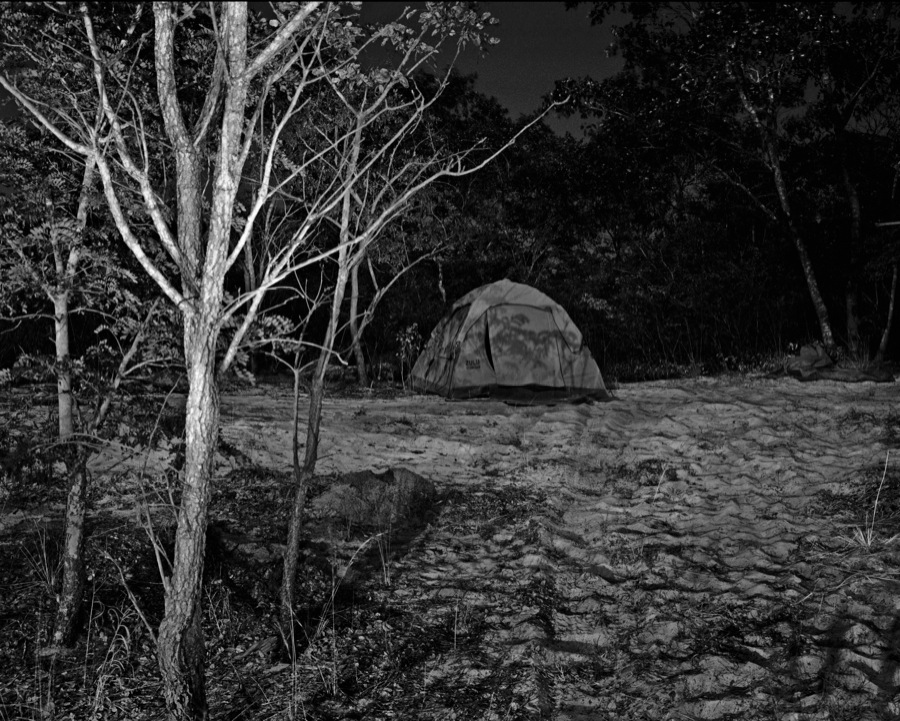 """Jo Ractliffe My tent at Longa,   from """"As Terras do Fim do Mundo"""",   2009 Stampa manuale ai sali d'argento / Hand-printed silver-gelatin print Courtesy The Walther Collection and Stevenson Gallery © Jo Ractliffe"""