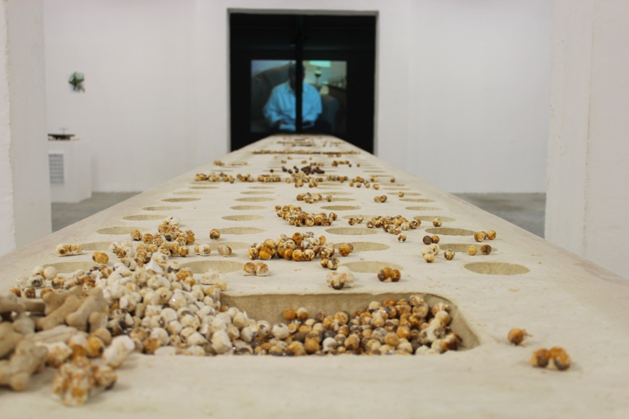 Uri Aran,   Untitled,   2014. Plaster,   metal ball bearings,   and dog biscuits,   85.5 x 77 x 1200 cm. Images courtesy of Peep-Hole,   Milan. Photo by  Francesca Verga