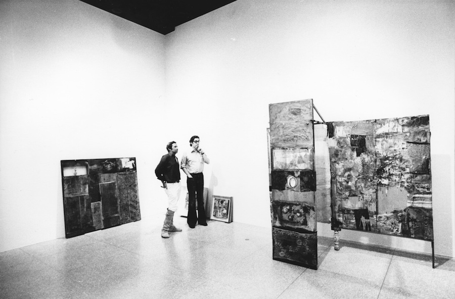 Rauschenberg and curator Walter Hopps,   installing Minutiae (1954) for the retrospective exhibition,   Robert Rauschenberg,   National Collection of Fine Arts,   Smithsonian Institution,   Washington,   D.C.,   1976. Photo: Gianfranco Gorgoni