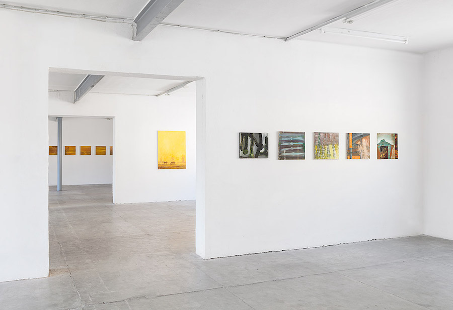 "Ull Hohn,   Untitled paintings from the series ""Pattern painting"",   1986-87,   oil on canvas rear: Ull Hohn Heavily Painted Yellow Sky,   1993,   oil on canvas Ull Hohn,   Untitled (Nine Landscapes),   1988,   oil on wood (9 elements) Installation view at Peep-Hole Milan,   2015 © 2015 Andrea Rossetti"