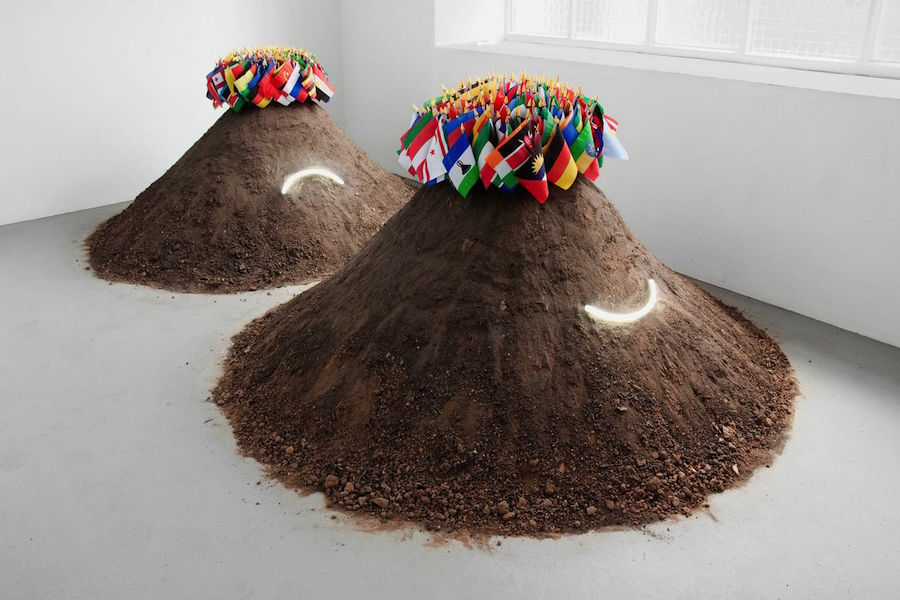 Jack Strange 'Good Haircut / Bad Haircut',   2011 Neon,   Soil,   Table Flags Dimensions variable Courtesy the artist and Limoncello esposto dalla galleria Limoncello,   London,   in occasione di miart 2015
