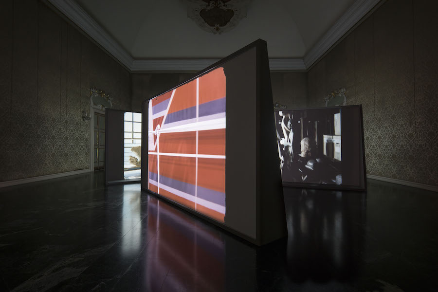 "Exhibition view ""I'll Be There Forever/ The Sense of Classic"" From the left: Rosa Barba The Hidden Conference: About the Discontinuous History of Things We See and Don't See,   2010 Film 35mm,   colore,   audio digitale ottico,   13:40 min. / 35-mm film,   colour,   optical sound,   13:40 mins. Courtesy of the Artist; The Hidden Conference: A Fractured Play,   2012  Film 35mm,   colore,   audio digitale ottico,   5 min. / 35-mm film,   colour,   optical sound,   5 mins. Courtesy of the Artist; The Hidden Conference: About the Shelf and Mantel,   2015 Film 35mm,   colore,   audio digitale ottico,   14 min. / 35-mm film,   colour,   optical sound,   14 mins. Courtesy of the Artist. Co-Produced by Acqua di Parma © Photo A.Osio"
