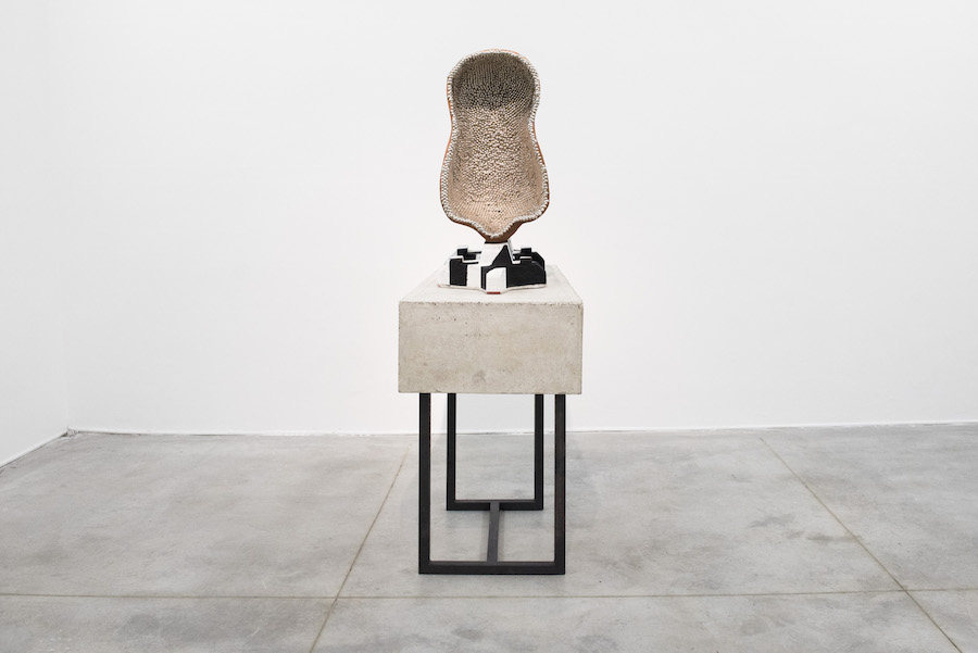 Benedikt Hipp,Console with pin-body mounted on repetition, (pneumopathologic studies), 2015 Concrete, iron, loam, bullen-nails, epoxy, color approx. 80 x 50x 170 cm  Photo credit: Massimo Valicchia Courtesy: the artist and Monitor, Rome-New York