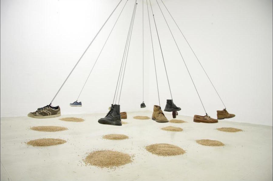 Leonard Sherifi The Triumph of Tragedy,   2015,   installation,   shoes,   wheat,   rope,   variable dimensions - Courtesy Biennale Mediterranea 17 – the artist