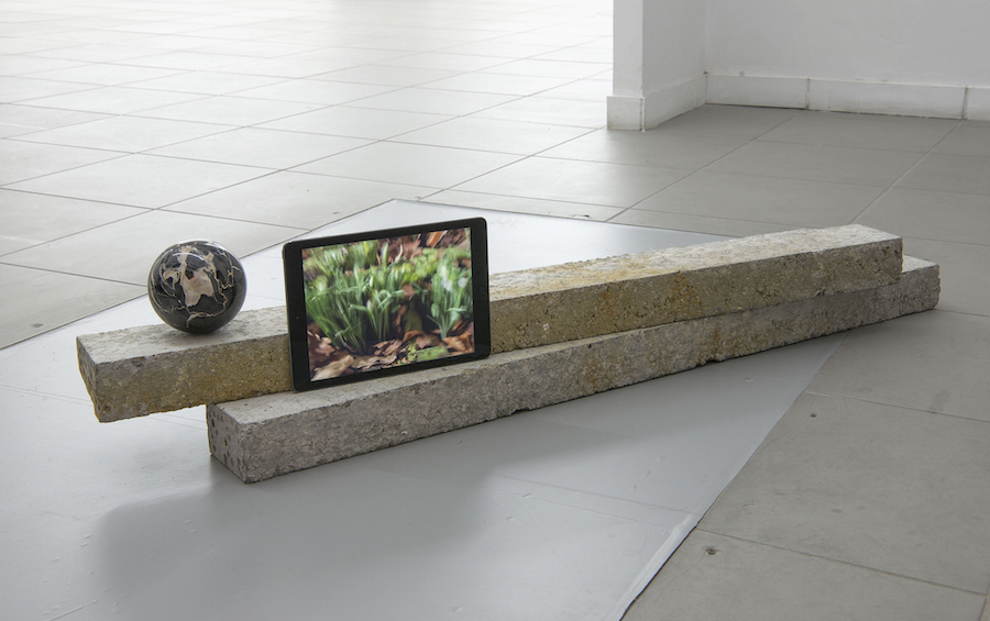 Untitled(Ground),   2015,   concrete,   Portoro marble 10cm Ø,   iPad (video in loop),   size variable,   courtesy The Gallery Apart Rome,   photo by Giorgio Benni