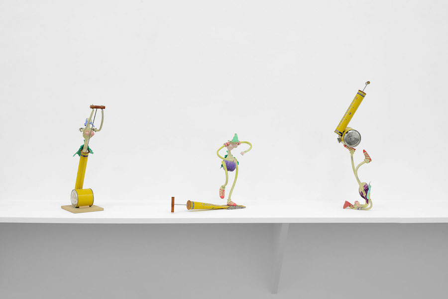"Louis Cane. left: Une ""femme canon"" dans un fly-tox,   2001-2002. painted bronze,   insecticide Fly-Tox,   wood. 54 x 20 x 15 cm"