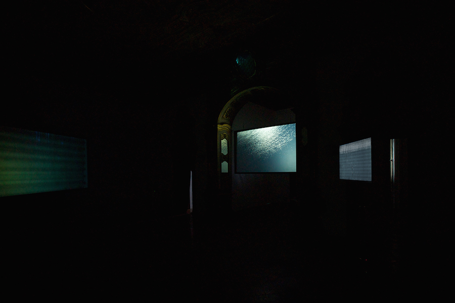 Em'kal Eyongakpa,   Beats/bits of(f) space(s) / Letters from Etokobarek,   21'21'',   3 channels film,   2016. Photo by PH. ROSSPEC. Courtesy Apalazzo Gallery