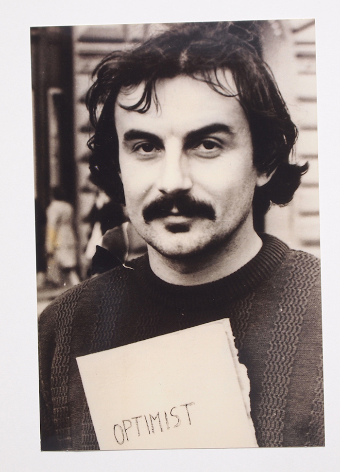 Vlado Martek,   Optimist (Poetic action Optimist during the exhibition-action,   Republic square),   1979,   bw photograph,   cm 10x15,   Courtesy Laura Bulian Gallery
