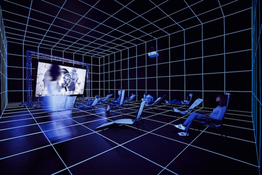 Hito Steyerl (b. 1966),   Factory of the Sun,   2015. High-definition video,   color,   sound; 22:56 min.,   looped; with environment,   dimensions variable. Installation view: Invisible Adversaries,   Hessel Museum of Art,   Bard College,   Annandale-on-Hudson,   New York,   2016. Bard College,   Annandale-on-Hudson,   New York; Marieluise Hessel Collection. Image courtesy of the artist and Andrew Kreps Gallery,   New York. Photograph by Sarah Wilmer