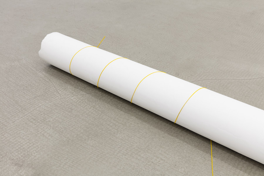 Gianni Caravaggio,   Il sole avvolge un paesaggio innevato 2016 plaster,   yellow cotton thread,   Kassel earth pigment 4,  9 x 106,  2 x 4,  9 in / 12,  5 × 270 × 12,  5 cm Photo: Andrea Rossetti - - Courtesy of the artist and kaufmann repetto,   Milano/New York