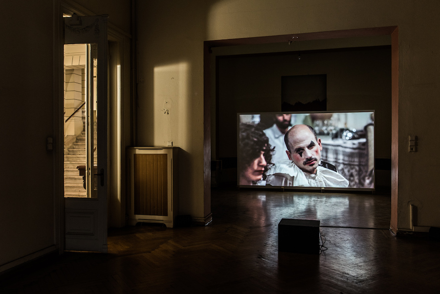 Jumana Manna, A Sketch of Manners (Alfred Roch's Last Masquerade) 2013, HD Video, 12 min. (co-scripted with Norman M. Klein) - Courtesy Jumana Manna and CRG Gallery- The Thickness of Time, installation view, Photo Credits Dimitris Parthimos