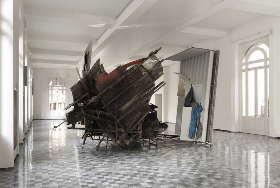 Peter Buggenhout, The Blind Leading The Blind # 65, 2014  iron, wood, aluminium, plasterboard, plaster, plexiglass, rubber, polyurethane, polystyrene, fabric, household dust 540 (h) x 660 x 985 cm Photo Credits: Dario Lasagni