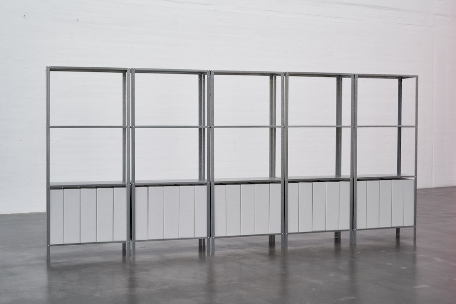 Manor Grunewald, untitled, 2016, aluminum shelves, cardboard boxes, printed panels, 140 x 300 x 27 cm,  photo Ben Hermanni, courtesy Berthold Pott Gallery Cologne