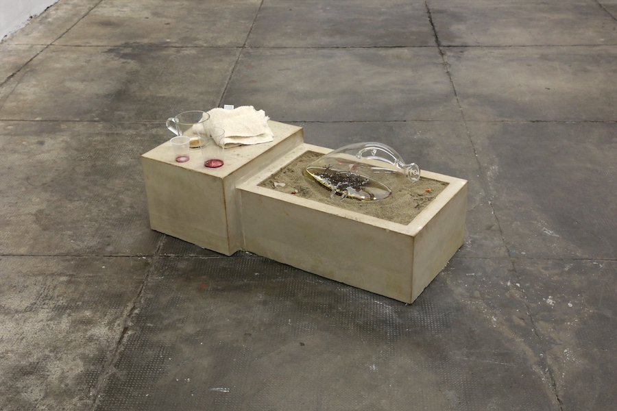 Libby Rothfeld Western Express, 2017 40 x 84 x 40 cm Blowing glass, wine stalks, white wine, plaster, pigments, foam, wire mesh, red wine, plastic cups, glass cup, coffee, sand, cigarettes, trash, towels.