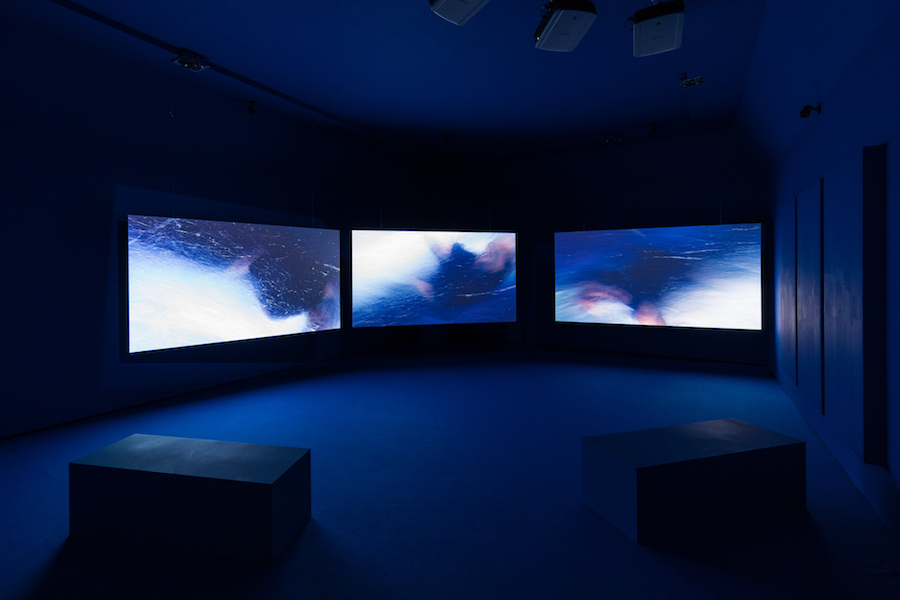 "Isaac Julien, Western Union: Small Boats, 2007 Three screen projection, 35mm colour film transferred to High Definition, 5.1 Surround Sound, 18'22"" Courtesy Isaac Julien and Victoria Miro Gallery, London © Gianluca Di Ioia - La Triennale"