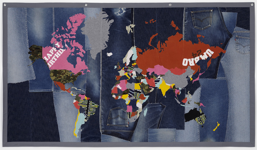 Jonathan Monk, The World in Jeans and T shirts, 2008 2009, Clothing collage, 116.5 x 202.5 cm, Courtesy the artists and Galleri Nicolai Wallner, Copenhagen copia