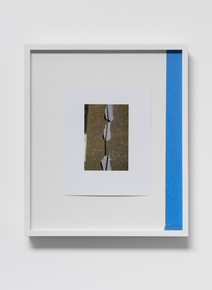Megan Plunkett, I Live by the River 15, 2017, digital c-print on glossy paper, artist's tape, cut IKEA table, 20.32 x 25.4 cm (framed 35.56 x 42 cm), Unique - -  Courtesy of The artist and Emalin, London – Photography Lewis Ronald