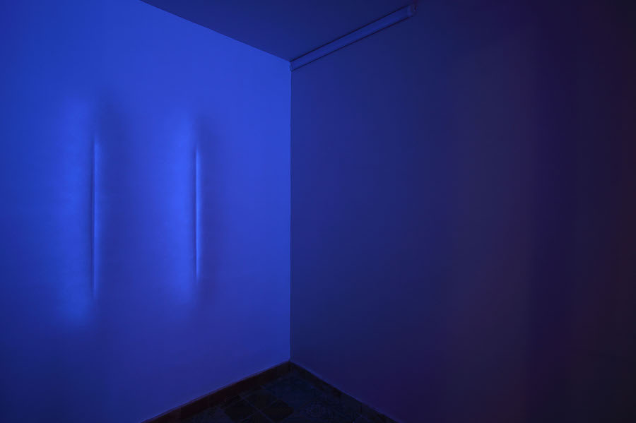 Giovanni Sortino, Infinito Presente (Essere), 2016, wall paint and fluorescent paint on wall, black light, dimensions variables