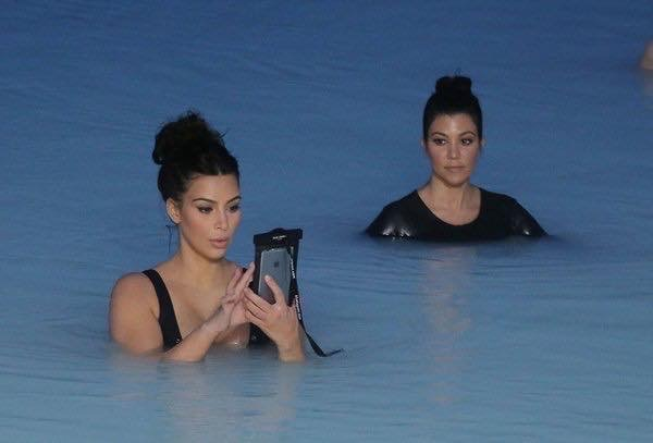 Kim Kardashian using her iPhone in the ocean - 2016
