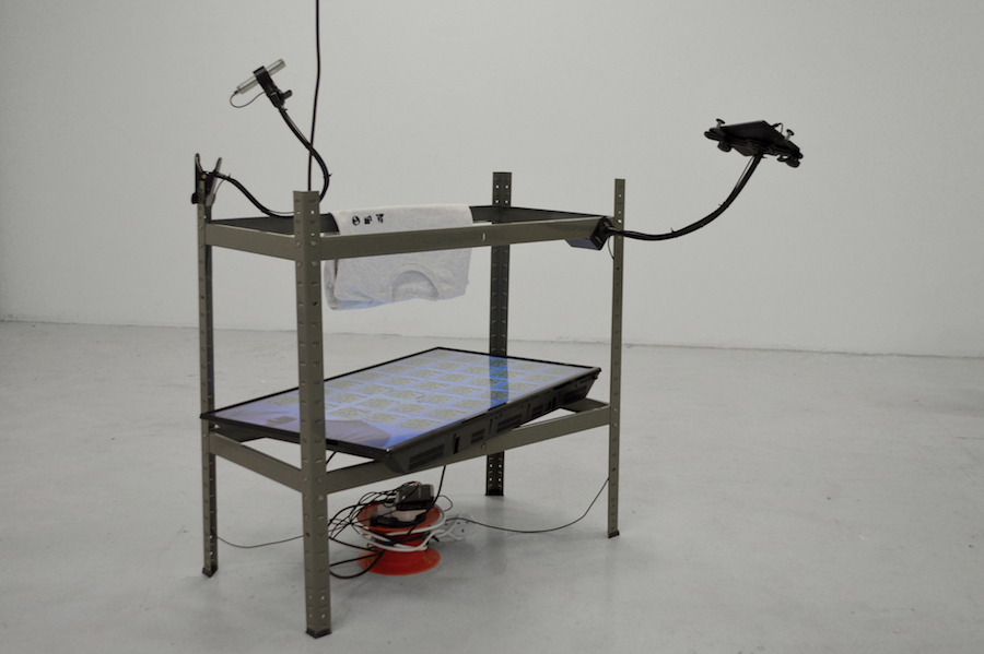 Bob Bicknell-Knight, Let's Be Friends (2016). Steel, Television screen, media player, kindle fire, iPhone, t-shirt, tablet mount, phone mount, extension cable, media player, USB flash drive, miscellaneous cables. Dimensions variable. Courtesy the Artist