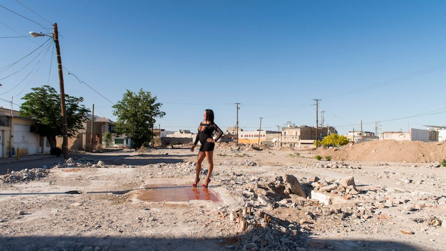 TERESA MARGOLLES. Pista de Baile de la discoteca Virginias, 2016, Transgender sex worker standing on the dance floor of a demolished club in Ciudad Juárez, Mexico.jpg
