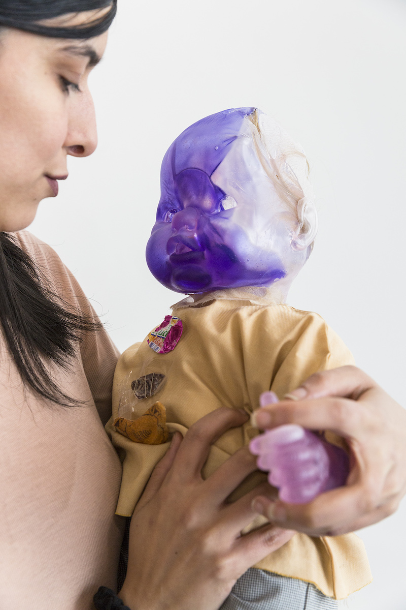 Lucia Leuci, Sculpture 2 (digestion), 2017, Resin, fabric, synthetic hair, stuffing, yarn, plastic, paper, shell, tangerine, ink, 64x50x16 cm, Holder Alaa El-Shaarawi, Photo Jan Kolský, Courtesy of the artist and Polansky Gallery