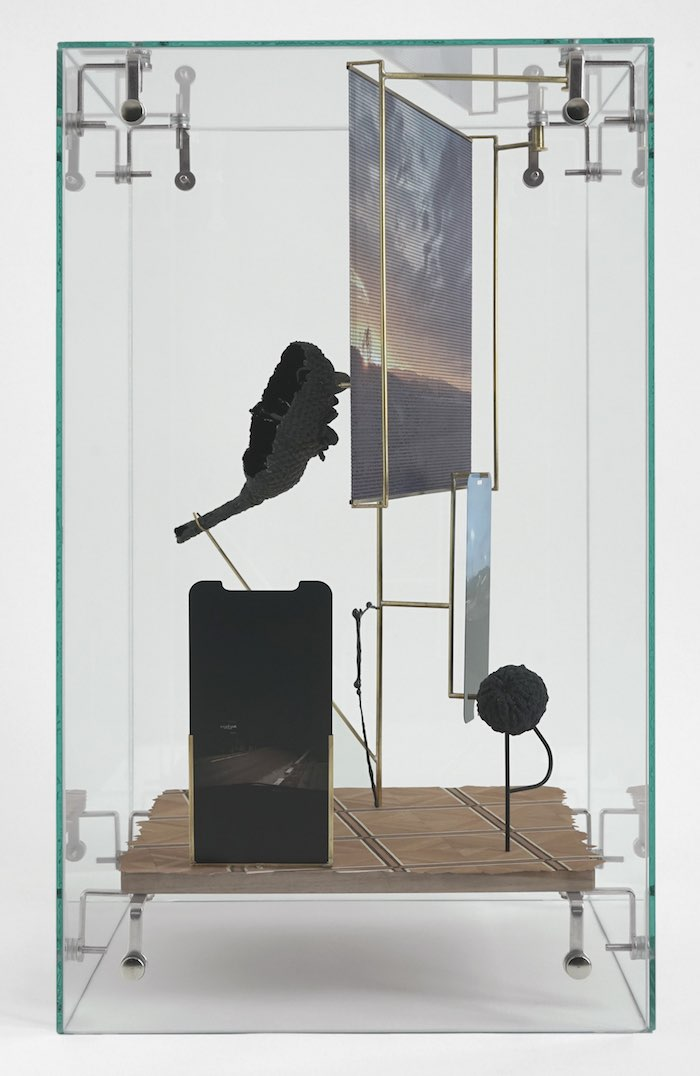 David Casini, Nirvana, 2019, glass, inlaid wood, brass, resin, tempered glass, aluminum, UV printing, 45 x 26 x 26 cm.