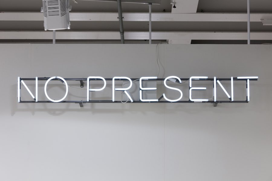 """Untitled (No Present), 2013 Wall mounted or suspended neon, 6500K. 12mm neon glass, back-painted. Frame mounted electronic transformer. 20 × 1,770 × 50 mm (¾"""" × 69 ⅝"""" × 2"""") Photo by James Thornhill Copyright Studio Claire Fontaine Courtesy of Claire Fontaine, Paris and Galleria T293, Rome"""