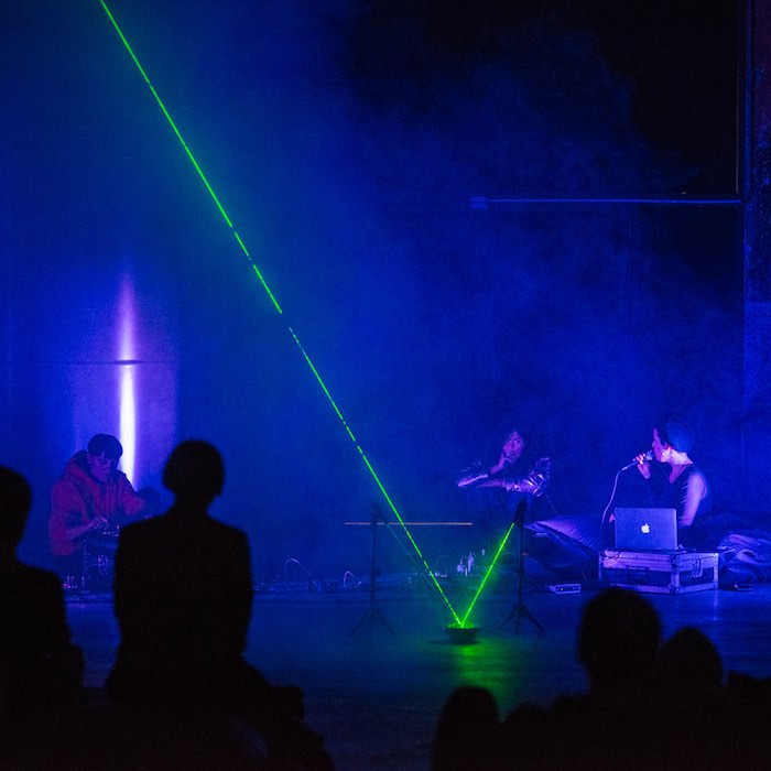 Dafne Boggeri, TISANA, (Adele H, Dafne Boggeri, Daniella Isamit Morales), sound performance, laser, rotating platform, crystal buttons, smoke machine, Dancing is what we make of falling, curated by Samuele Piazza and Valentina Lacinio, OGR Turin, 2018.